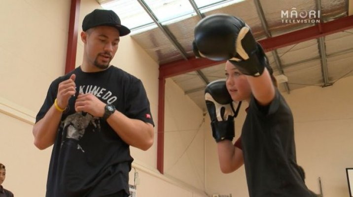 Joseph Parker guides young boxing student with her jab