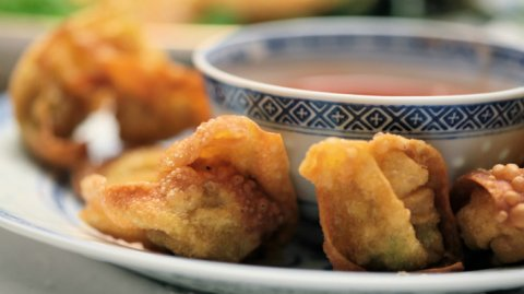 Fried Wontons with Dipping Sauce presented on a plate